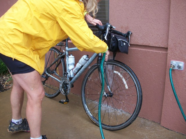Hosing down the bike at the hotel