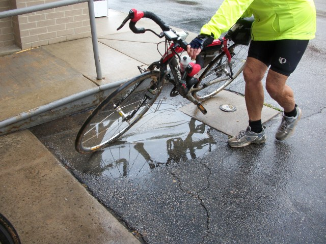 Trying to clean bike in a puddle