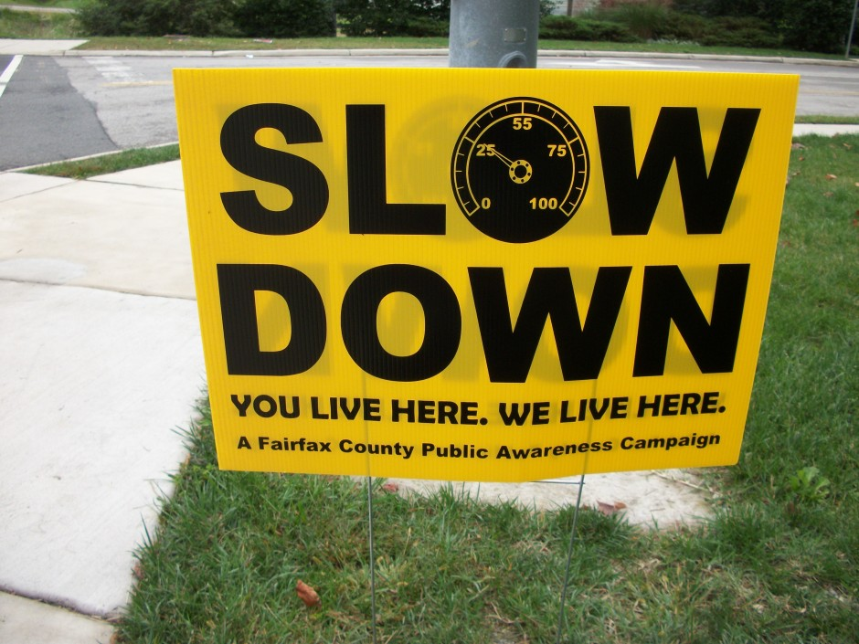 Sign says Slow Down. You live here. We live here.