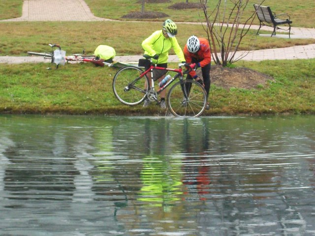 Washing bike in a ;pond